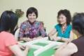 three-senior-women-and-mature-woman-playing-mahjong